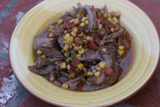 Tex Mex potroast is cooked using canned tomatoes and chiles (Rotel), corn, and chipotle chile powder. This is a great pot roast or chuck roast recipe that will feed at least 8 people. It also freezes well!