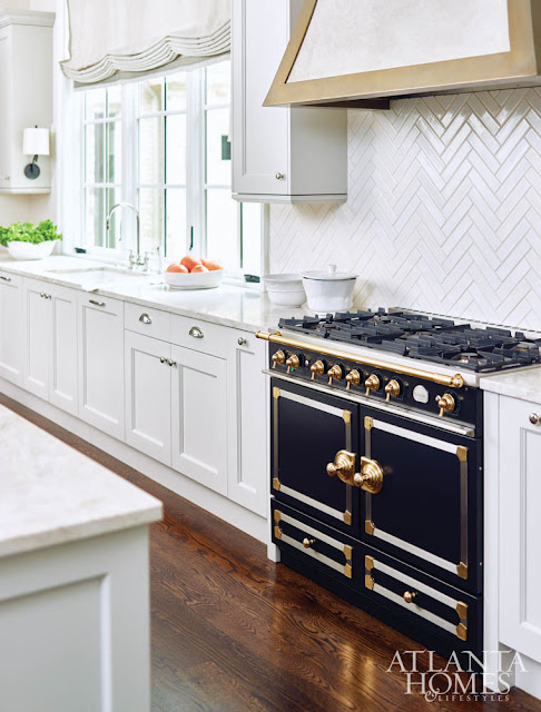 Black and Gold Vintage Style Range in White Glossy Kitchen