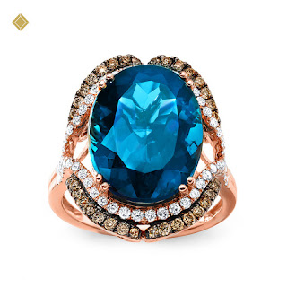 Nhẫn vàng 14k đính kim cương và đá topal xanh