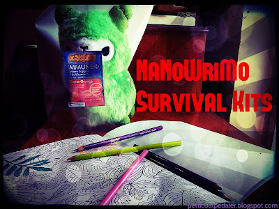 Green plushie alpaca holding a packet of the Emergen-C while standing over a coloring book and surrounded by color pencils.   Text reads: NaNoWriMo survival kits