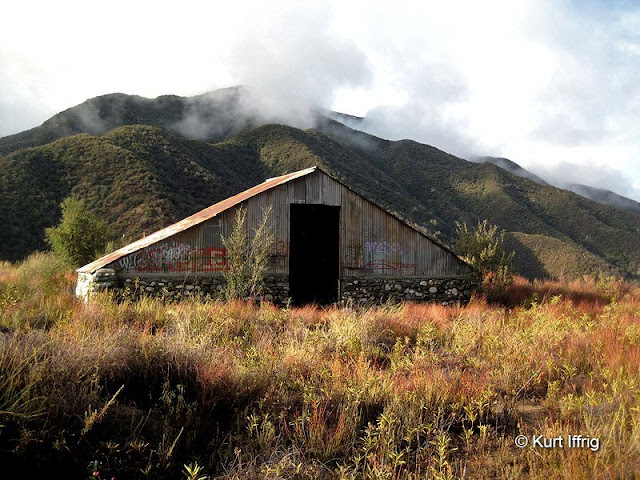 This barn or shed lies abandoned in a field just above the East Fork, near Camp 19's helipad.