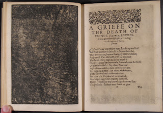 An open book, the left side entirely dark and the right printed with text.