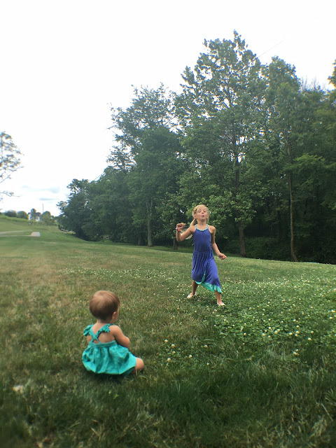 kids enjoying the green lawn at Brianza Gardens and Winery