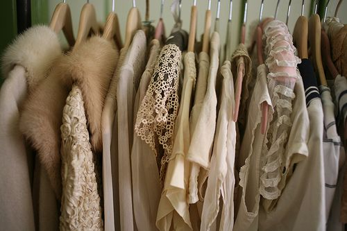 Hanging Rack of Clothing: Dresses and Furs
