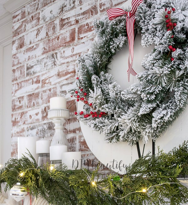 candles and garland on Christmas mantle