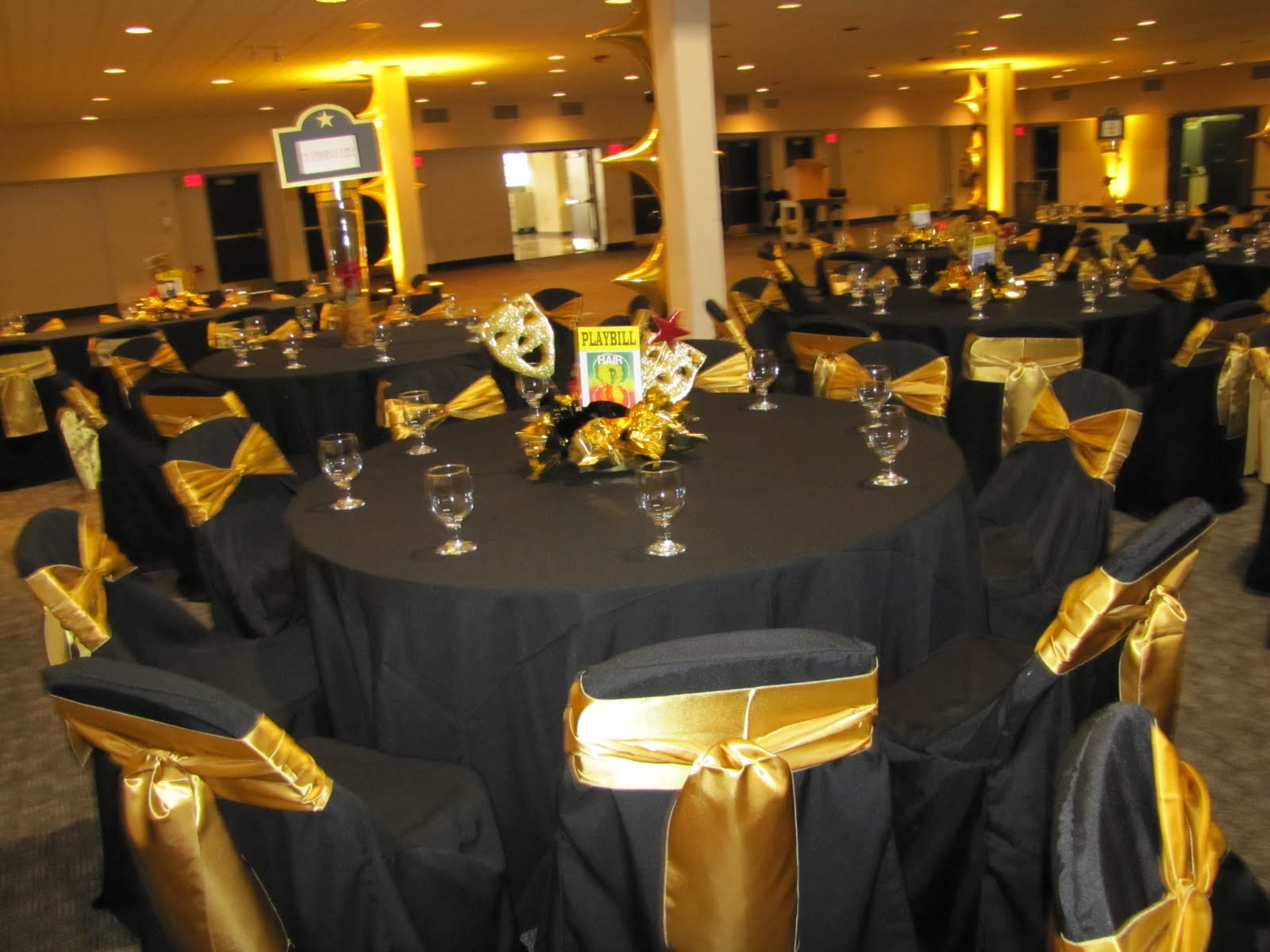 party people event decorating company broadway themed Black and Gold Centerpieces for Tables black and gold table centerpiece ideas