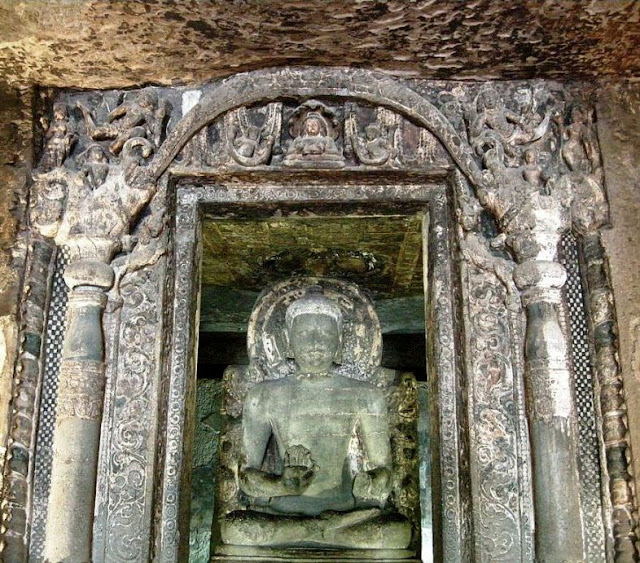 Buddha in the lower cave 6 shrine - note the intricate door frame
