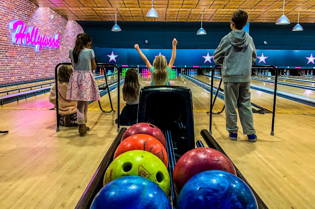 Children watching closely to see what score they will get at bowling