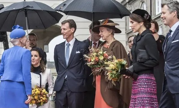 Princess Marie wore Paule Ka White Two Tone Belted Coat and Jimmy Choo pumps. Crown Princess Mary, Princess Benedikte abd Queen Margrethe