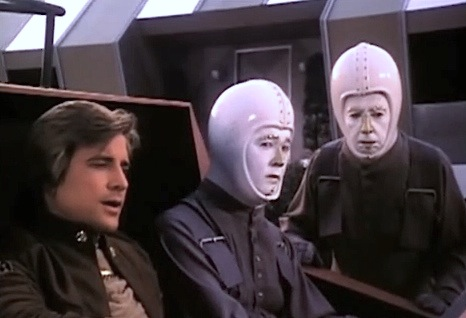 Battlestar galactica saga of a star world classic image starbuck hector and vector the robots from the feature length episode greetings from earth shown as a two parter in its original uk 1981 premiere on londons thames m4hsunfo