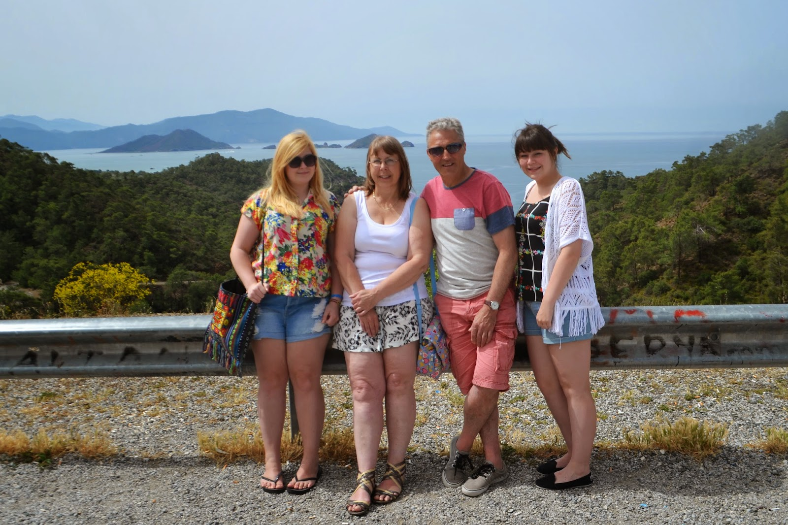 My whole family standing at a viewpoint near the Blue Lagoon