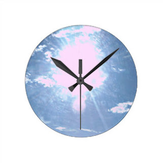 Blue sky with sun rays wall clock