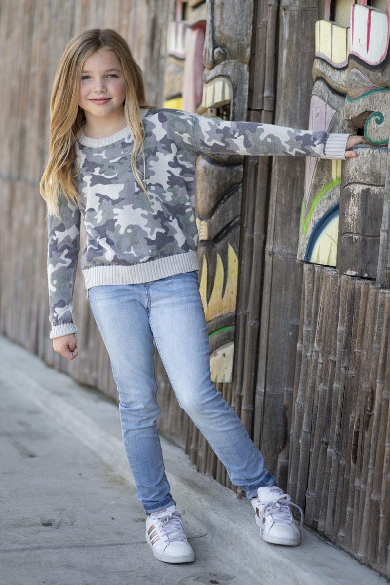 model wearing Graffiti Gloss camo sweater