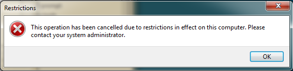 صورة للنافذة Restrictions تظهر رسالة This operation has been cancelled due to restrictions in effect on this computer. Please contact your system administrator