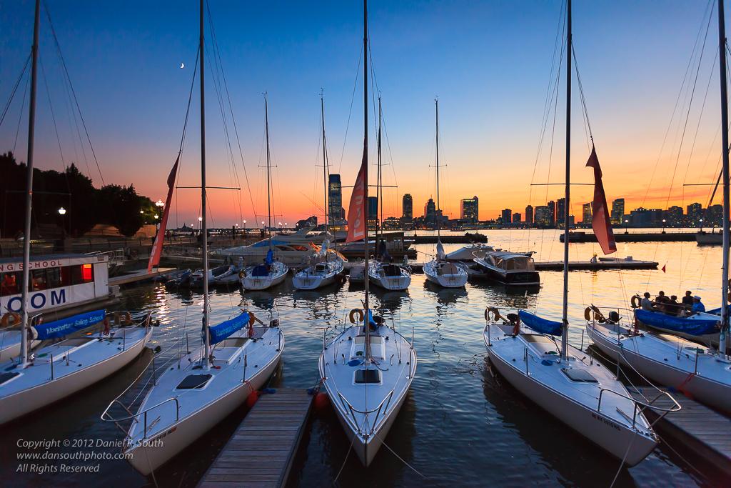 a photo of sailboats at the world financial center marina