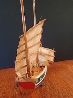 Bow detail of model of small Chinese junk