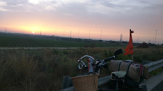 bike on the side of the road - with sunset in the back in south israel