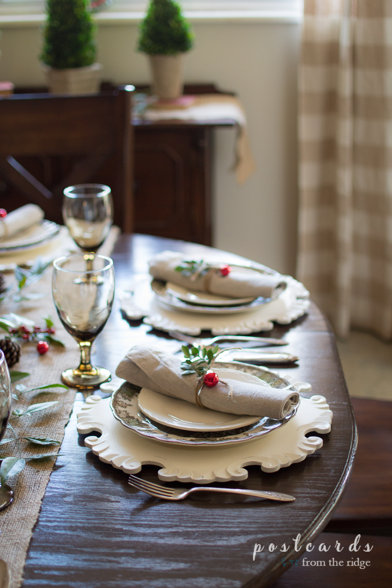 Love this pretty Christmas tablescape with rustic, natural, and vintage items.