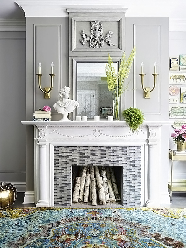 Pretty Little Details Inspiration Files // Living room with stunning mouldings and intricate fireplace.