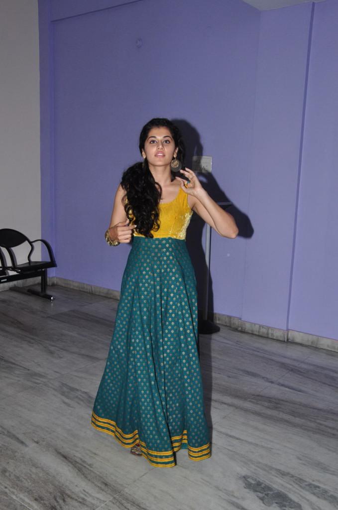 Tapsee yellow dress at press meet