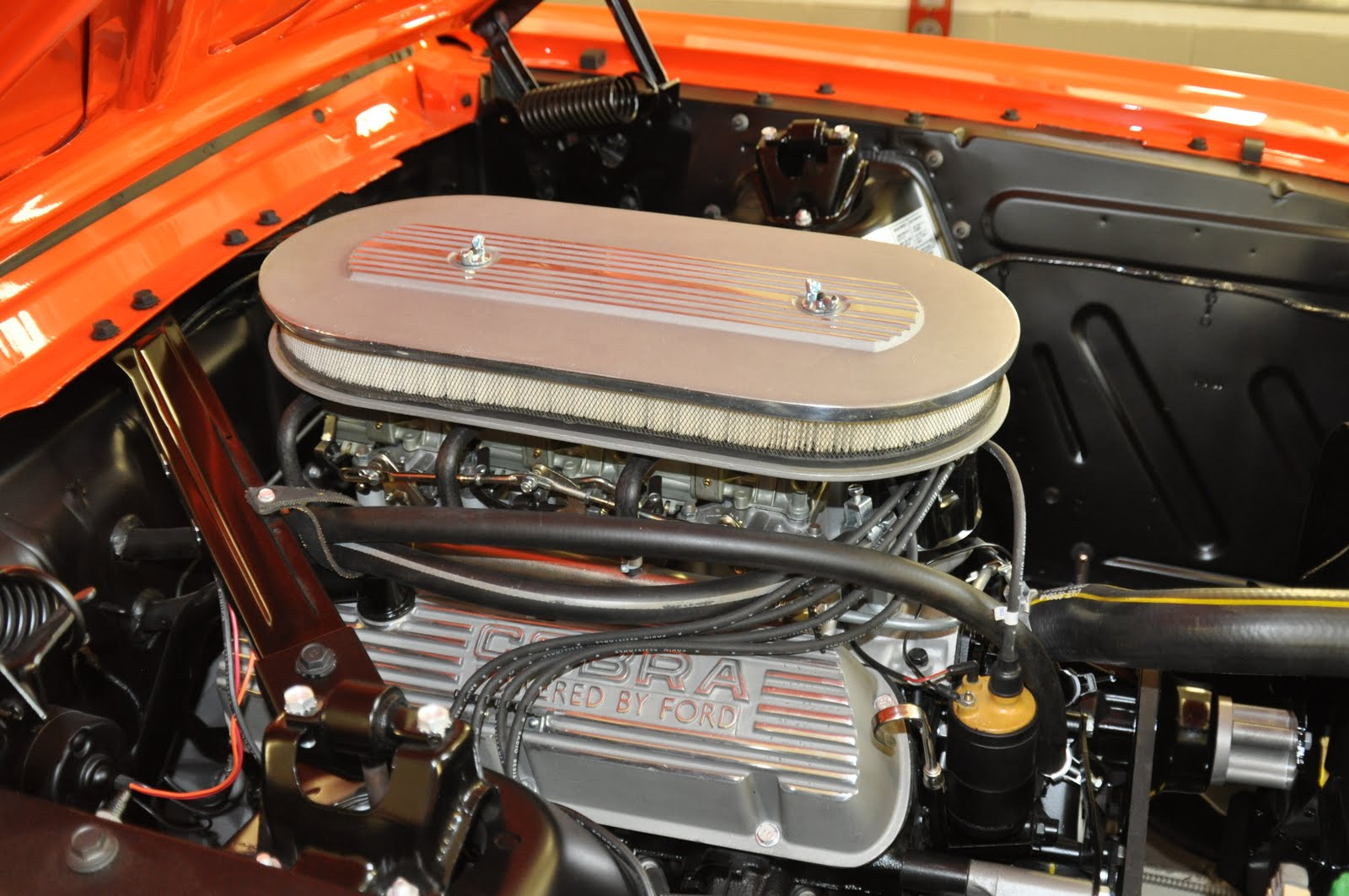 1965 Mustang Tri-Power set up with Buddy Bar manufactured open letter Cobra  Aluminum Valve Covers. All images ©Virginia Classic Mustang Inc.