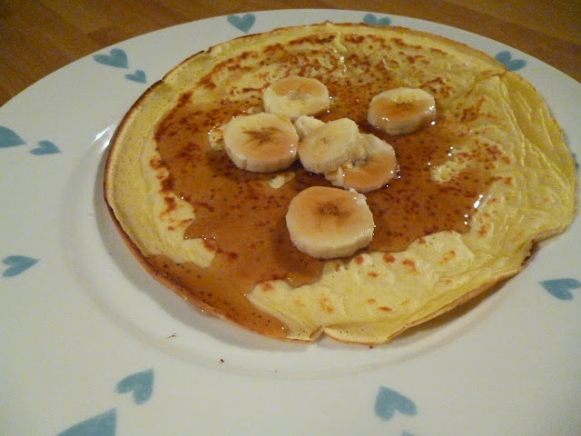 organic pancake with banana and maple syrup