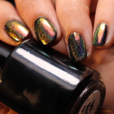 Swatch of Born Pretty Store peacock holographic nail powder item #40683 over black nail polish