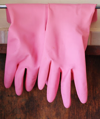 Dumpened rubber glove is use in removing hair and lint in cleaning jewelry displays.