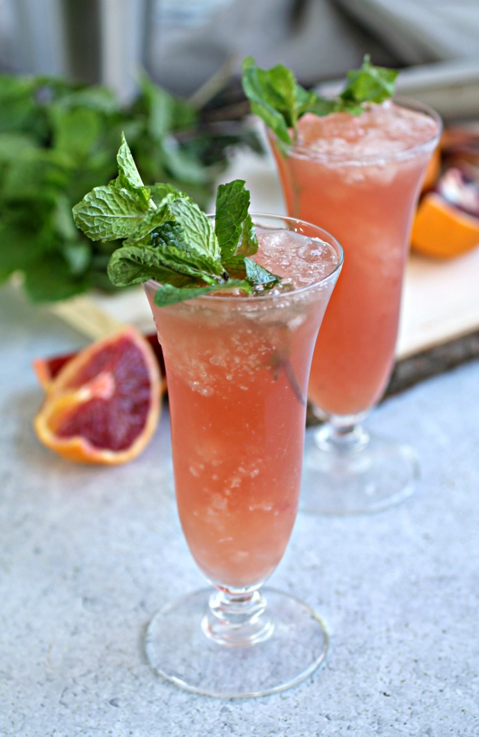 Recipe for a bourbon cocktail flavored with fresh mint and blood orange juice.