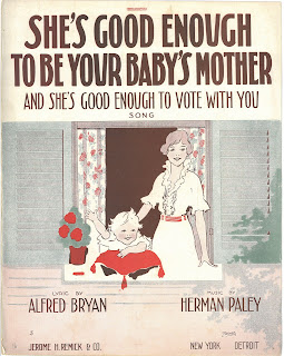 "Cover of ""She's Good Enough to be Your Baby's Mother and She's Good Enough to Vote with You!"" The image depicts a domestic scene with a smiling woman in a dress and her rosy cheeked infant looking out a window. The child is waving."