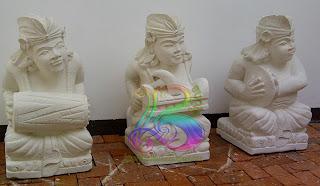 Patung orang bali batu paras