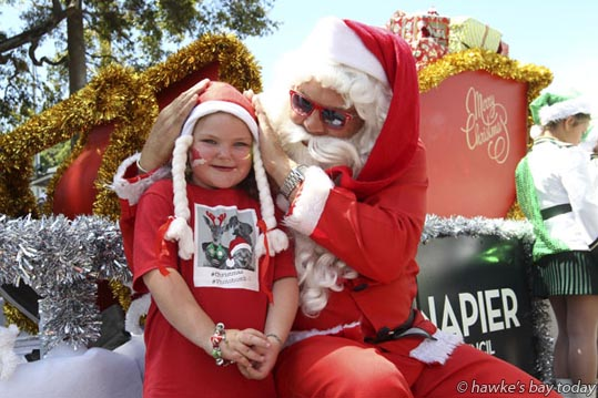 Lacey Hacker, 6, Napier, with Santa, after the Napier Christmas Parade along Emerson St, from Herschell St to Clive Square, Napier.  photograph