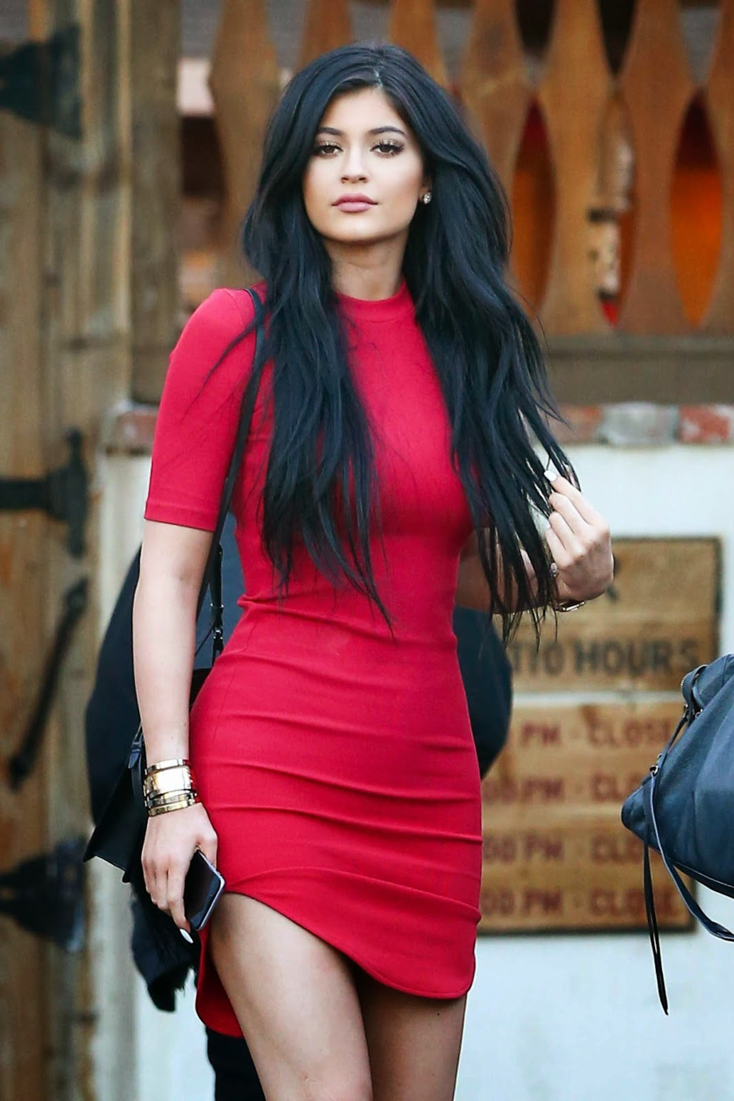 Kylie Jenner shows off legs in a figure hugging red mini dress in Calabasas