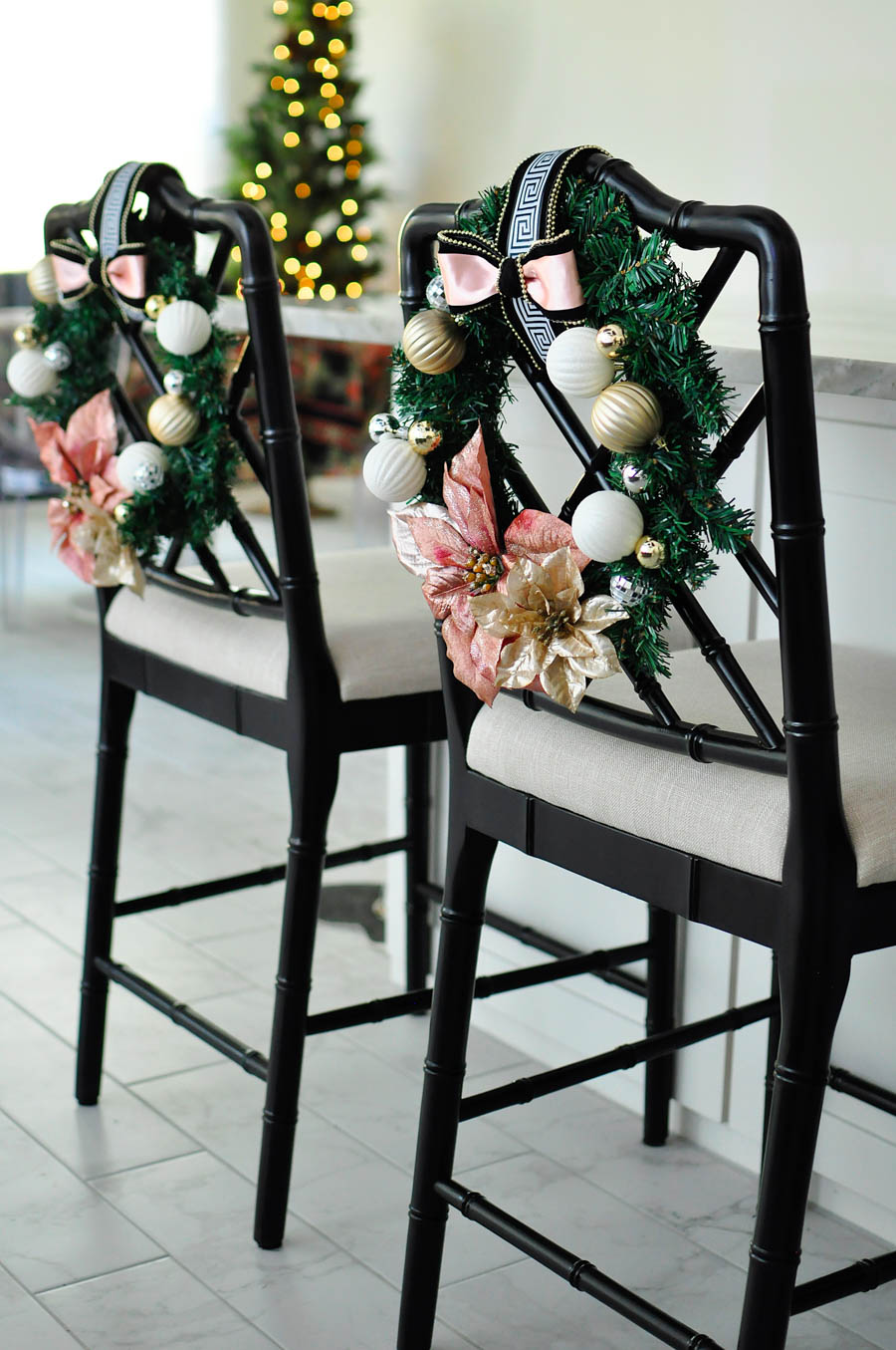 A craft tutorial for a gorgeous and glam blush, white, and gold chair wreath perfect for holiday and Christmas decor in a kitchen or dining room. Love the Greek Key accents!