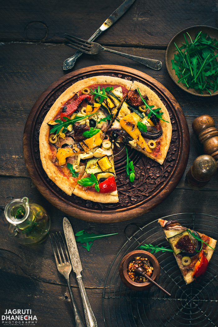 Cast your senses back to that perfect European holiday with this Rustic Pizzeria style Chargrilled Vegetable Pizza. A hearty wholemeal base topped with a fragrant tomato sauce and layers of chargrilled veg. A perfect weekend treat as well as for the midweek!
