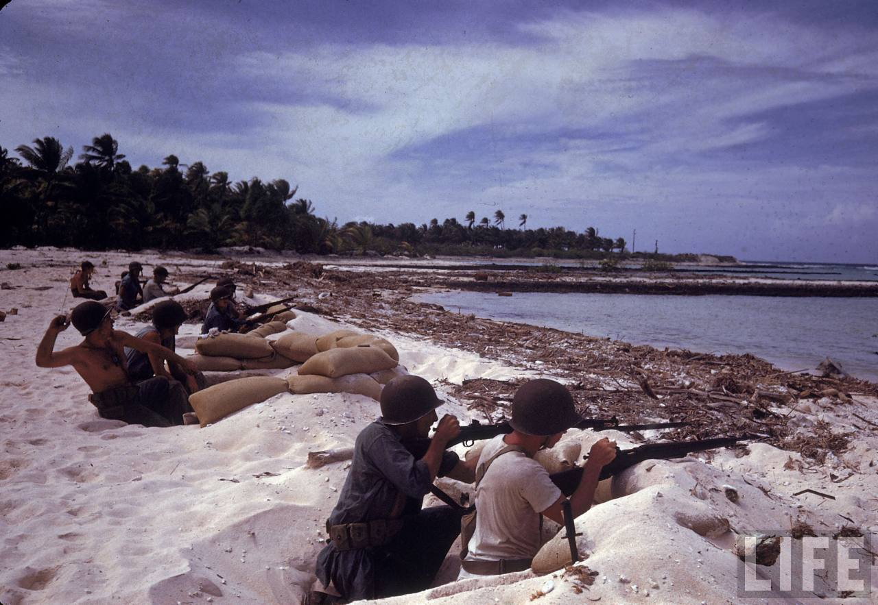 American Soldiers Manning Gun Nests Protecting The Island Shore During WWII