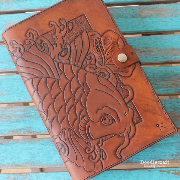 http://www.doodlecraftblog.com/2014/11/leather-tooled-book-cover-with-koi-and.html
