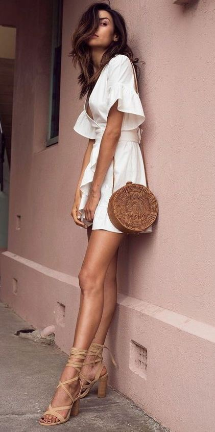 how to style a round bag : white ruffle dress and lace up heels