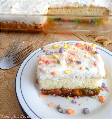 Sweet and Tart Cake, a French Vanilla cake with a gooey sweet and tart surprise. | Recipe developed by www.BakingInATornado.com | #recipe #cake