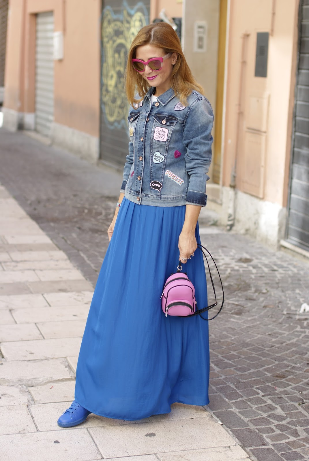 Denim jacket with patches and blue maxi skirt worn with sneakers on Fashion and Cookies fashion blog, fashion blogger style