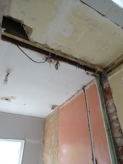 gap in ceiling where old wall used to be