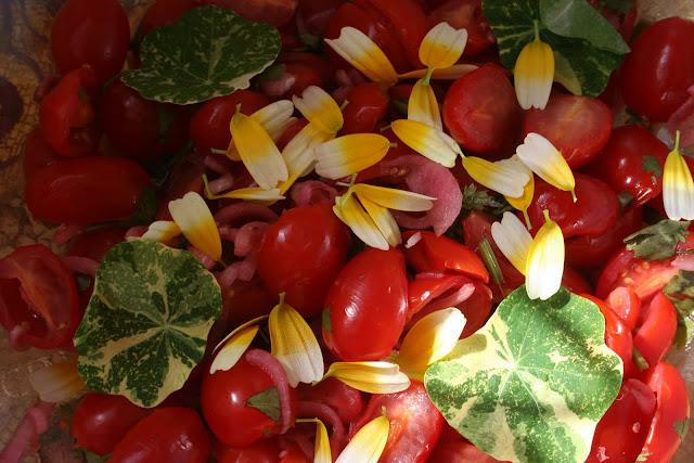 Cherry tomatoes, marigold petals, nasturtium leaves salad