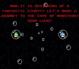 Captura del arcade Bubble Booble. Muestra a Bub y Bob dentro de unas burbujas y un texto de introducción que da comienzo a nuestro viaje