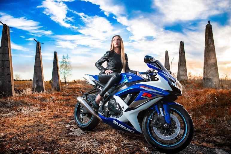 Woman In Black Leather Jacket Sitting On Blue And White Suzuki Gsx-r