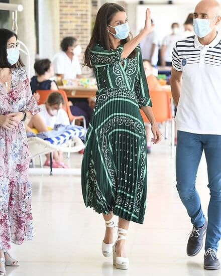 Queen Letizia wore a scarf print long dress from Sandro, and espadrille wedges from Macarena. Queen Letizia wore Sandro long dress