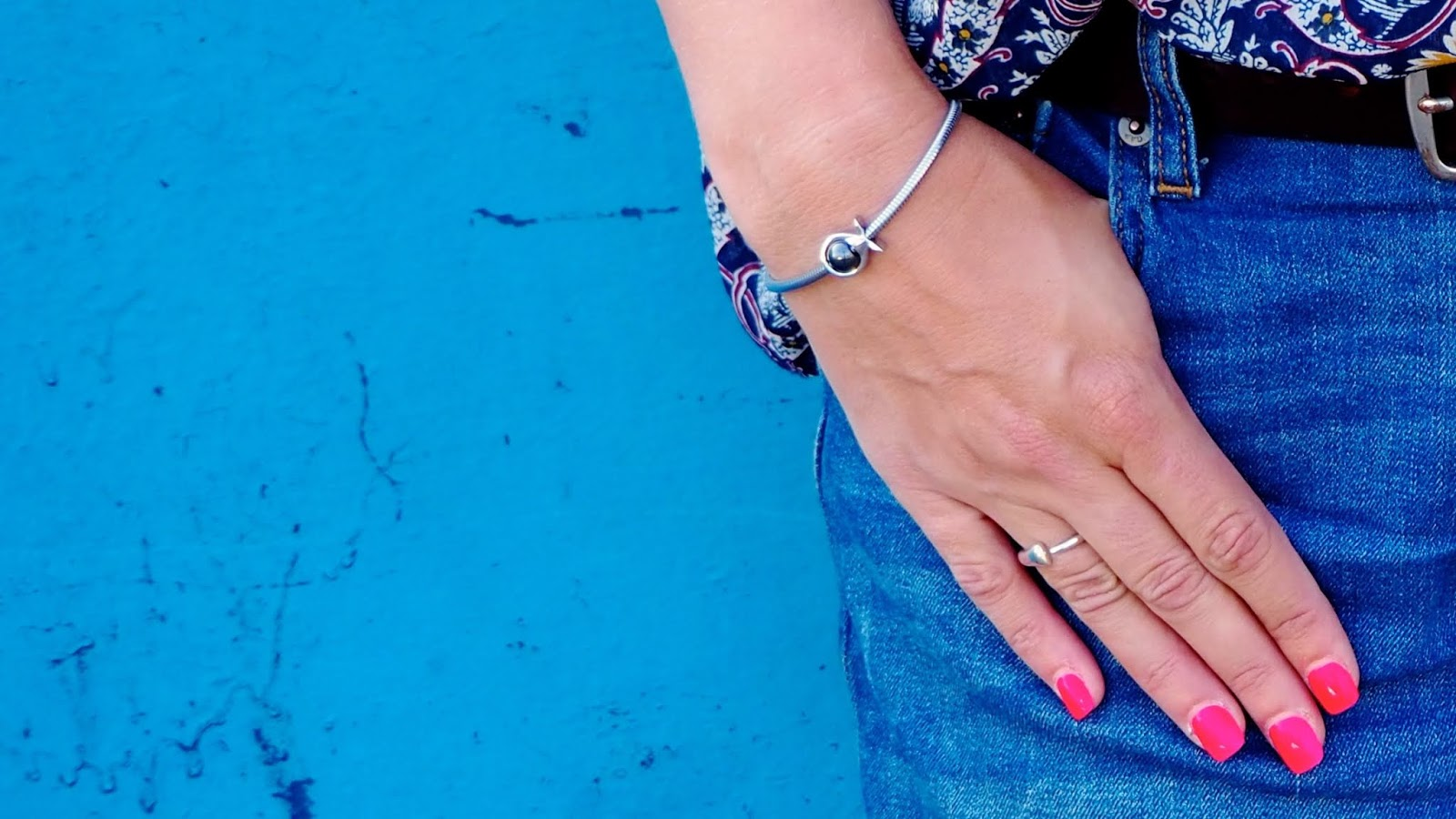 silver bracelet and pink nails