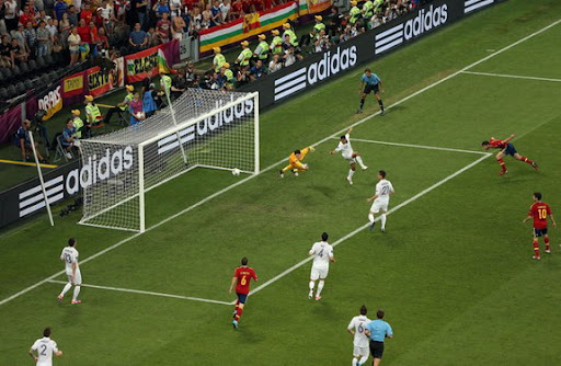 Spain midfielder Xabi Alonso heads in the opening goal past France goalkeeper Hugo Lloris