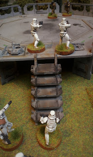 Rebels defend against Stormtroopers assaulting up the Landing Pad stairs