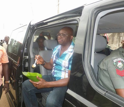 Fayose Spotted Doing What Ekiti Voted him To Do, Eating Ofada Rice By The Roadside