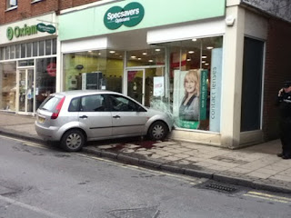 car crashed into opticians shop funny fail